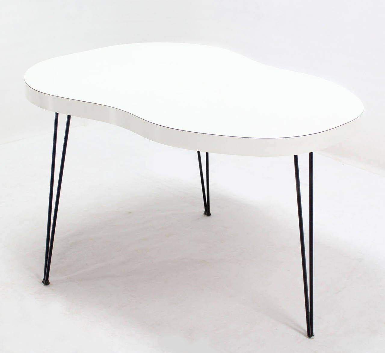 Unusual organic guitar shape dining table on three hairpin for Odd shaped dining room tables