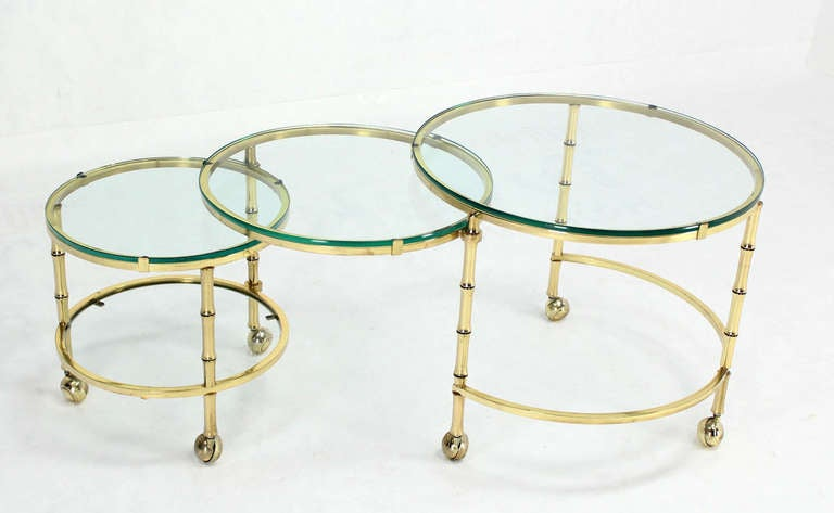 Unusual  design round solid brass faux bamboo expandable coffee table.         In style of Maison Bagues