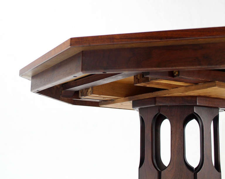oiled walnut octagonal two leaf dining table in the style
