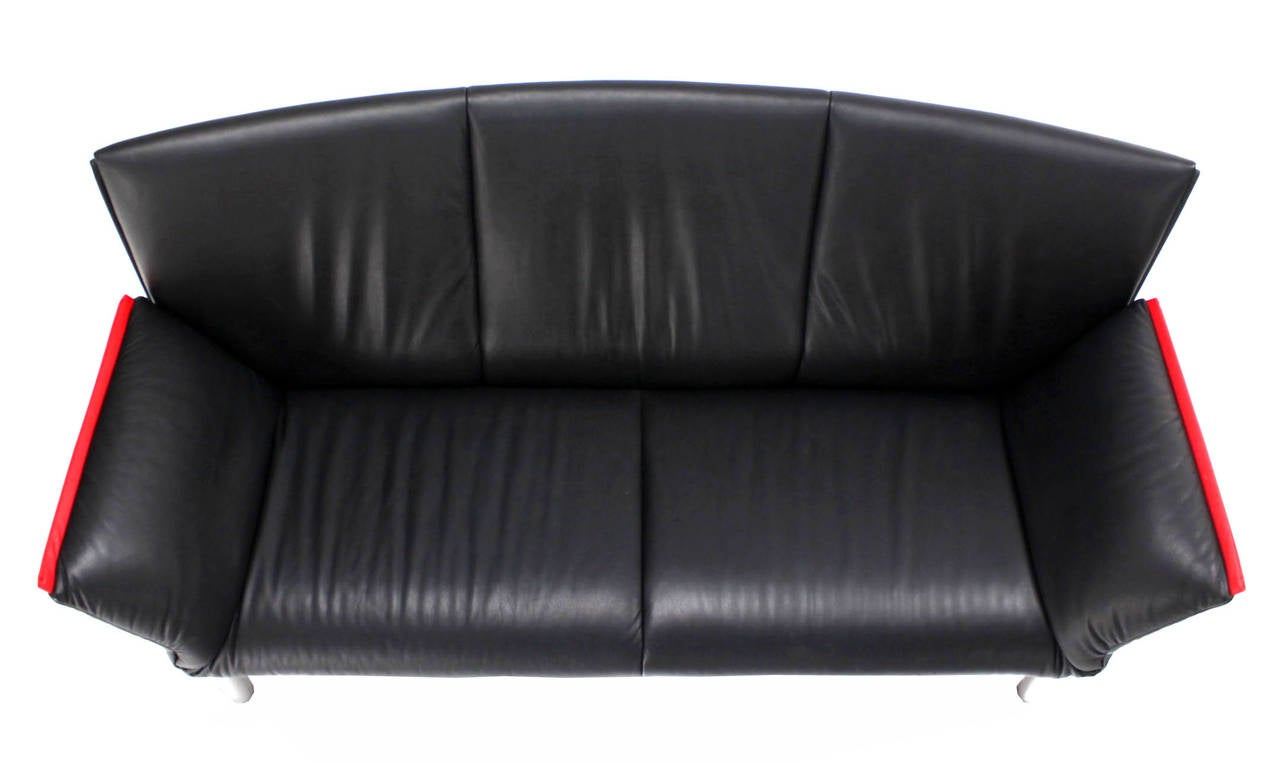 This De Sede Vintage Black Leather Sofa with Drop-Down Arms is no
