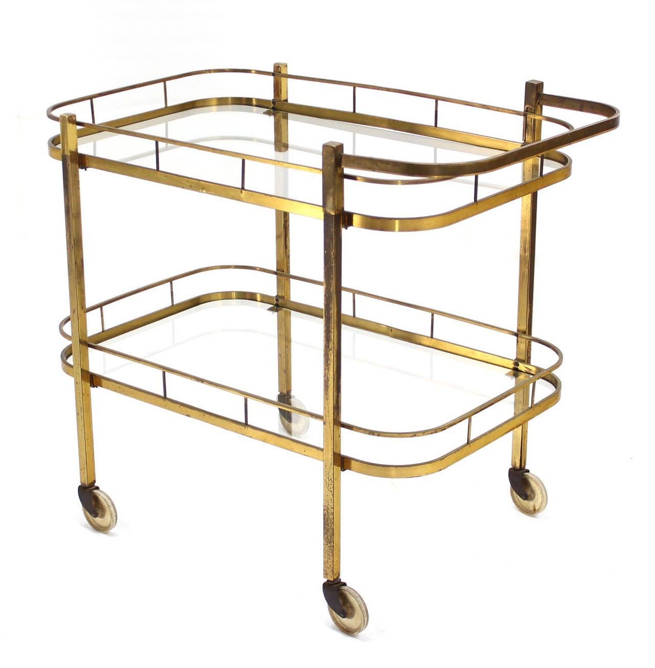 Very nice mid-century modern brass tea cart bar. All solid brass design.