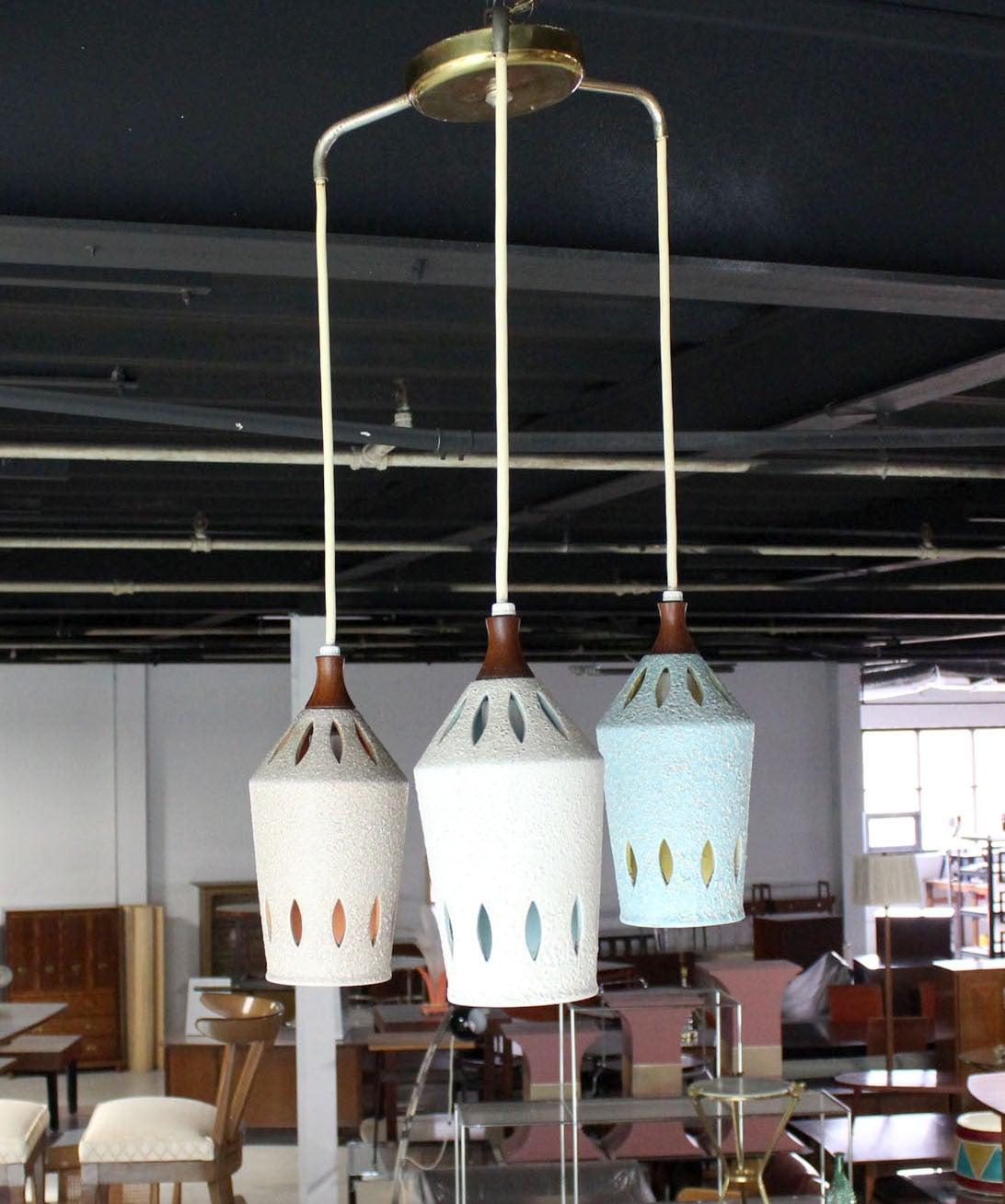 "Triple  pendant Danish modern light fixture. Each pendant measure 5x11"". Pierced ceramic pattern. Blue yellow white peach."