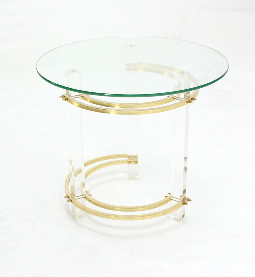 Lucite brass and glass round side table.