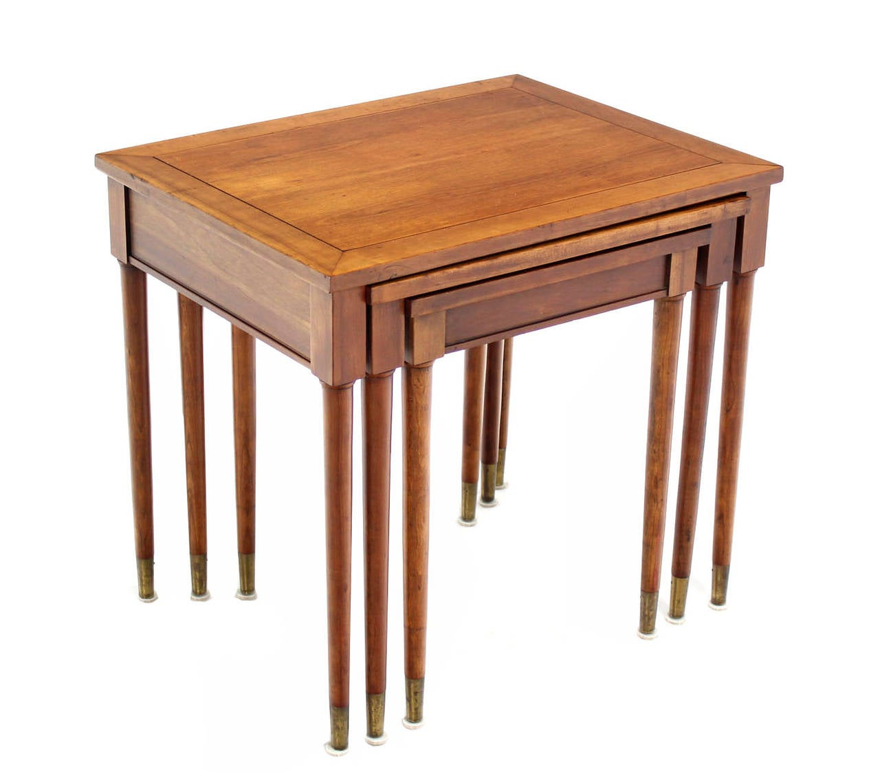 Set of three mid-century modern walnut or cherry nesting tables.