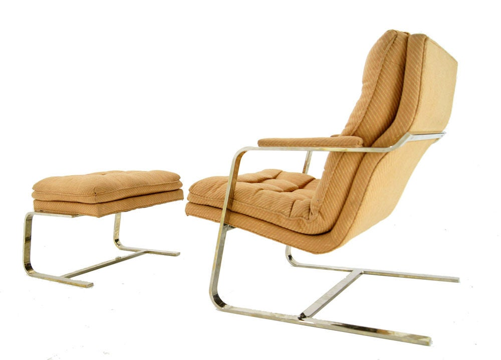 this mid century modern lounge chair and ottoman is no longer