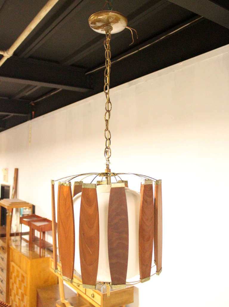 this vintage teak and brass mid century danish modern light fixture