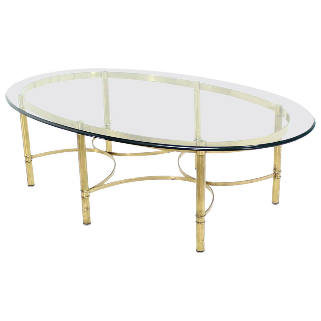 Oval brass and glass coffee table for sale at stdibs