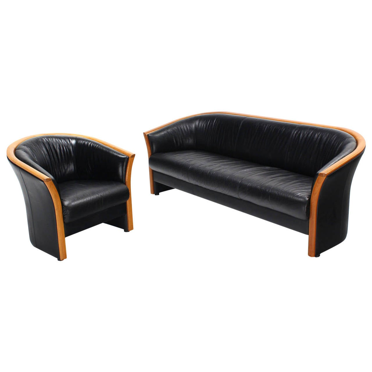 danish modern teak and black leather sofa and barrel back