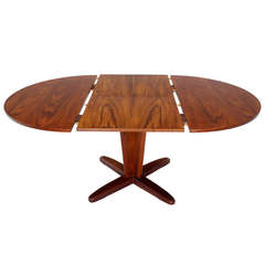 Danish Mid Century Modern Round Dining Table with Extendable Folding Leaf