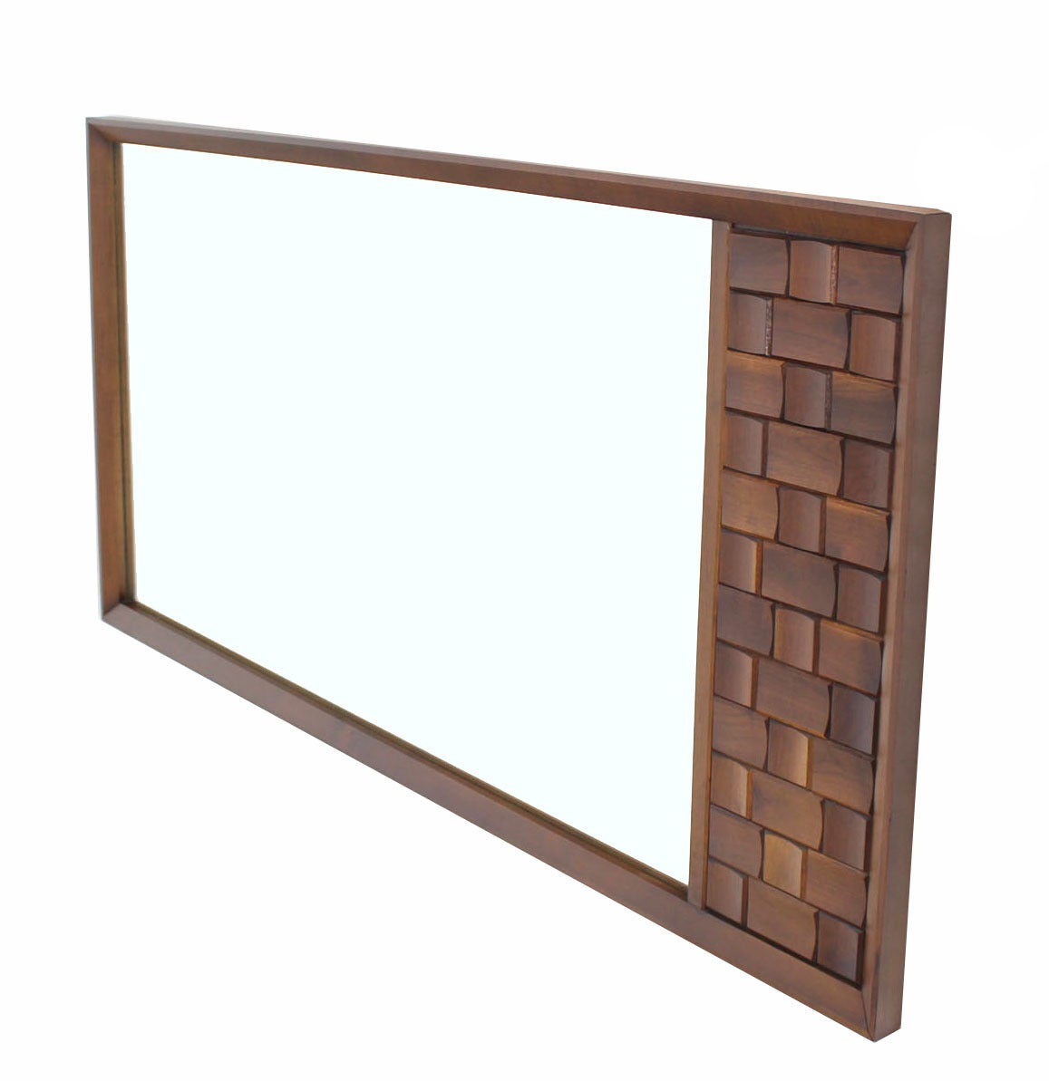 Nice large vintage mid-century modern mirror with solid walnut decorative carving panel.