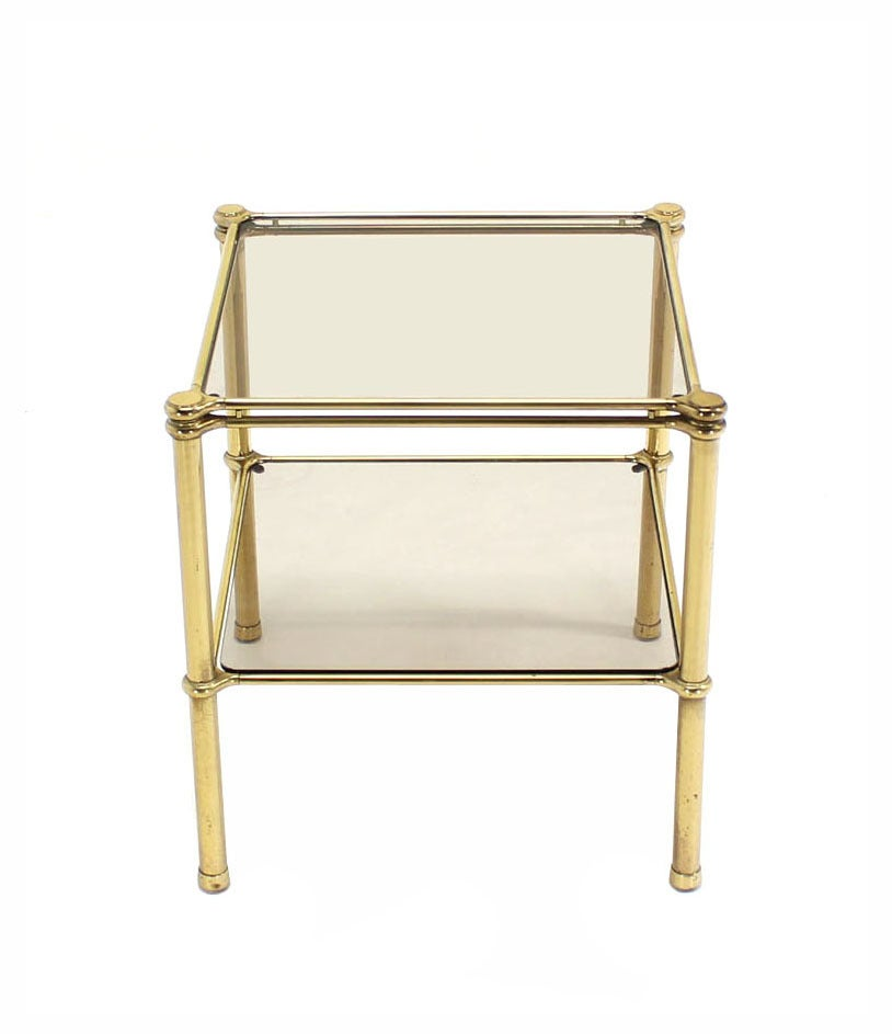 Mid-Century Italian modern brass side or end table stand with smoked glass shelves.