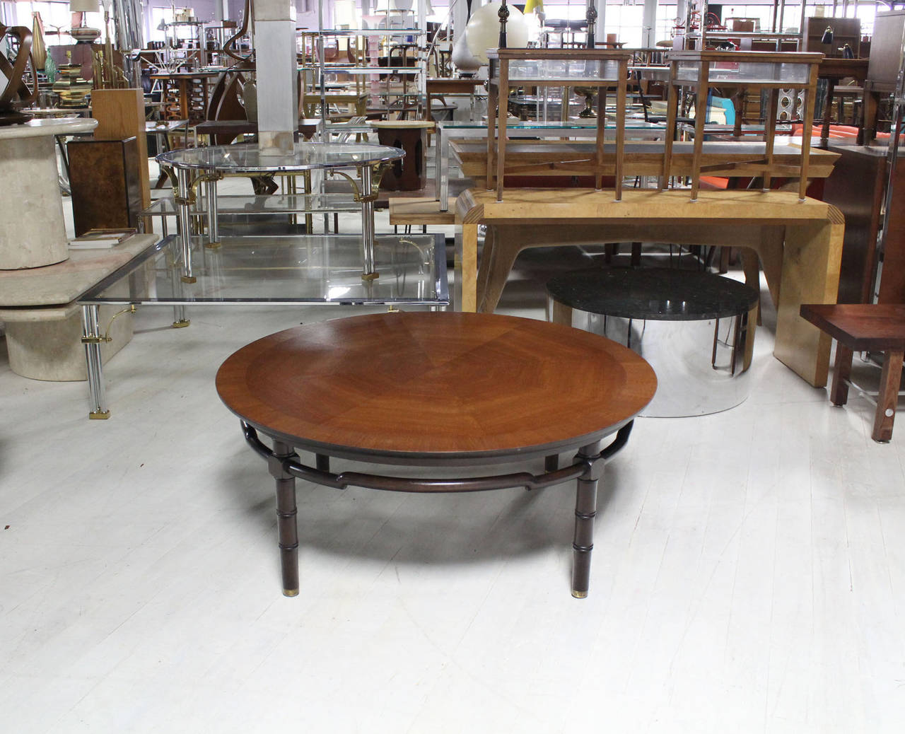 round coffee table with ebonized faux bamboo leg figural stretcher