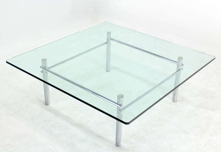 Solid chrome base with heavy steel bars and square glass for Heavy glass coffee tables