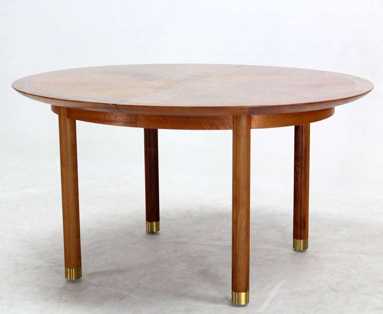this baker mid century modern walnut oval dining table with one leaf
