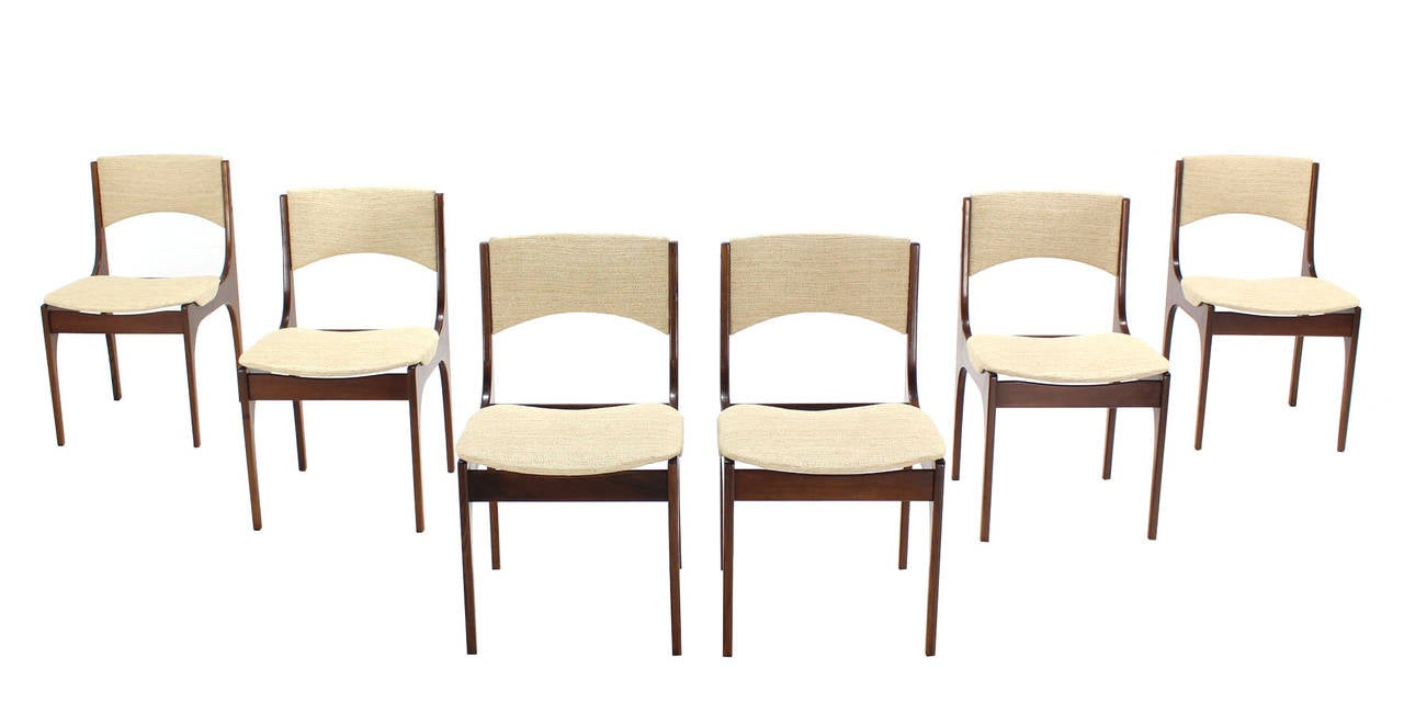 Set of six solid teak Italian mid century modern dining chairs with new upholstery.