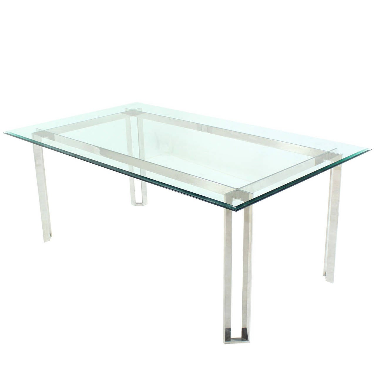 Polished stainless steel and thick glass top dining room for Glass dining table
