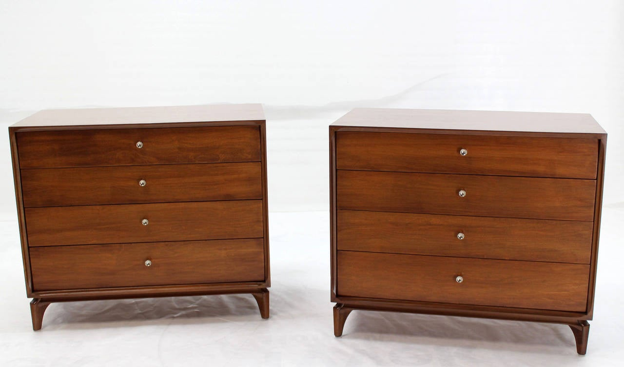 Pair of nice mid century modern bachelor chests or dressers in excellent condition. Beautiful walnut wood grain. Nice brass cone shape pulls.