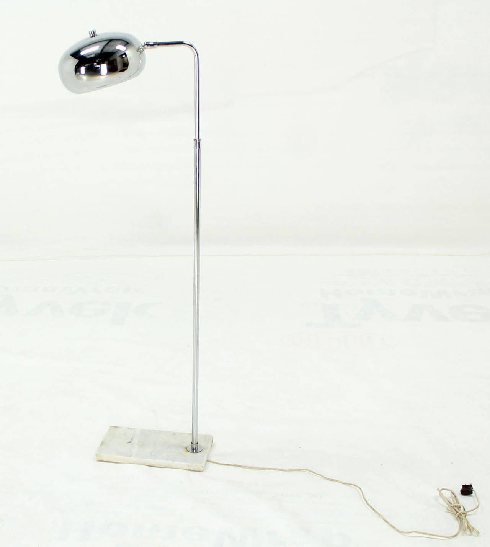 Mid century modern chrome adjustable dome shape shade reading lamp on marble base.