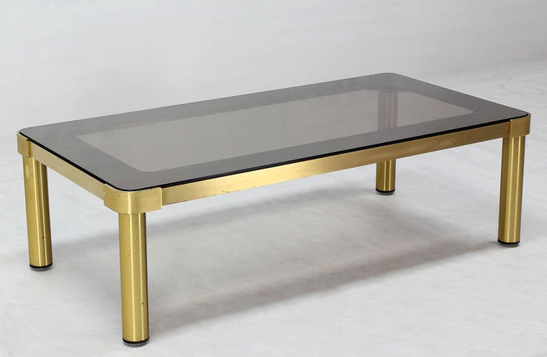 Rounded corners  quality brass and glass coffee table attributed to Mastercraft.