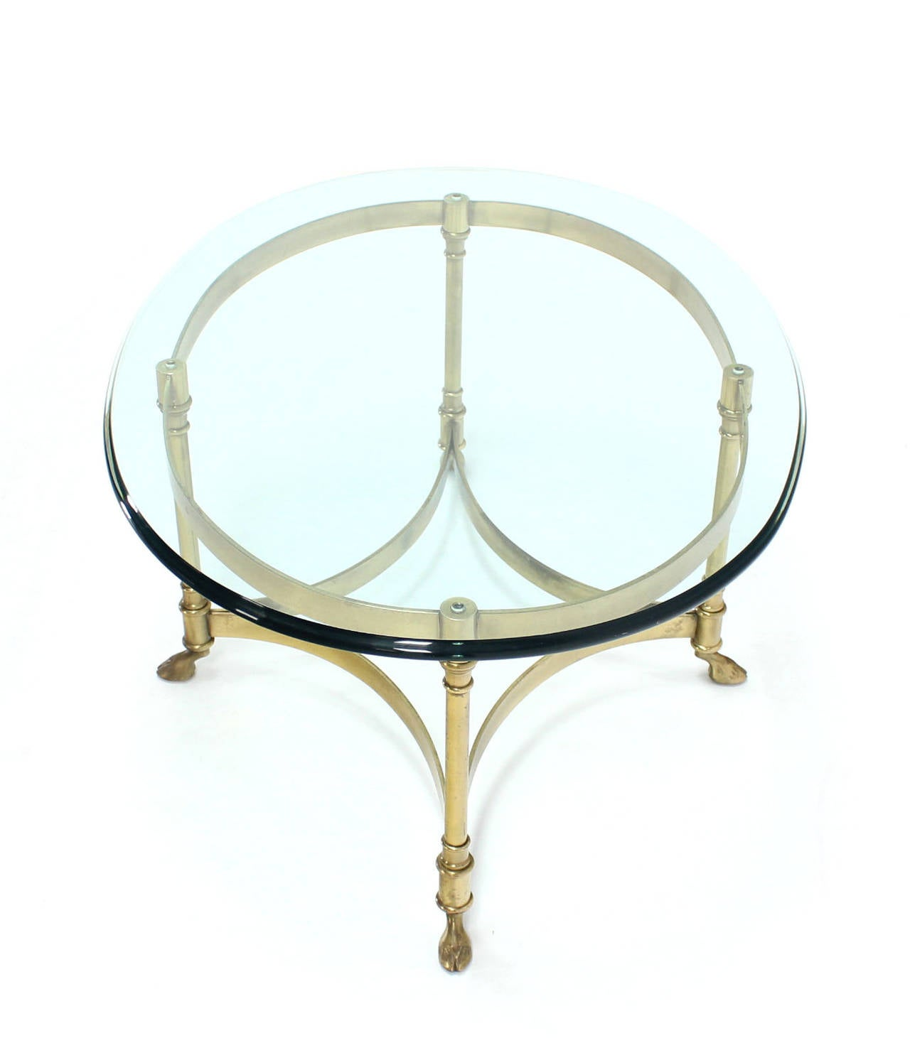 Brass and glass oval hoof feet coffee table at 1stdibs for Brass and glass coffee table
