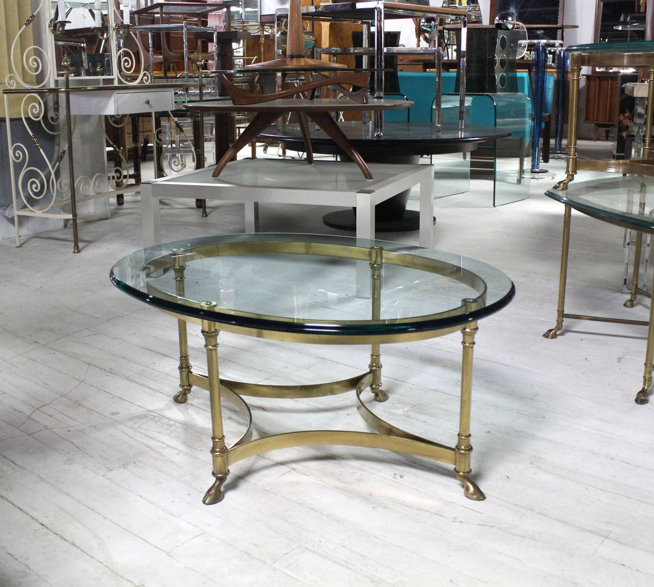 Brass And Glass Oval Hoof Feet Coffee Table At 1stdibs