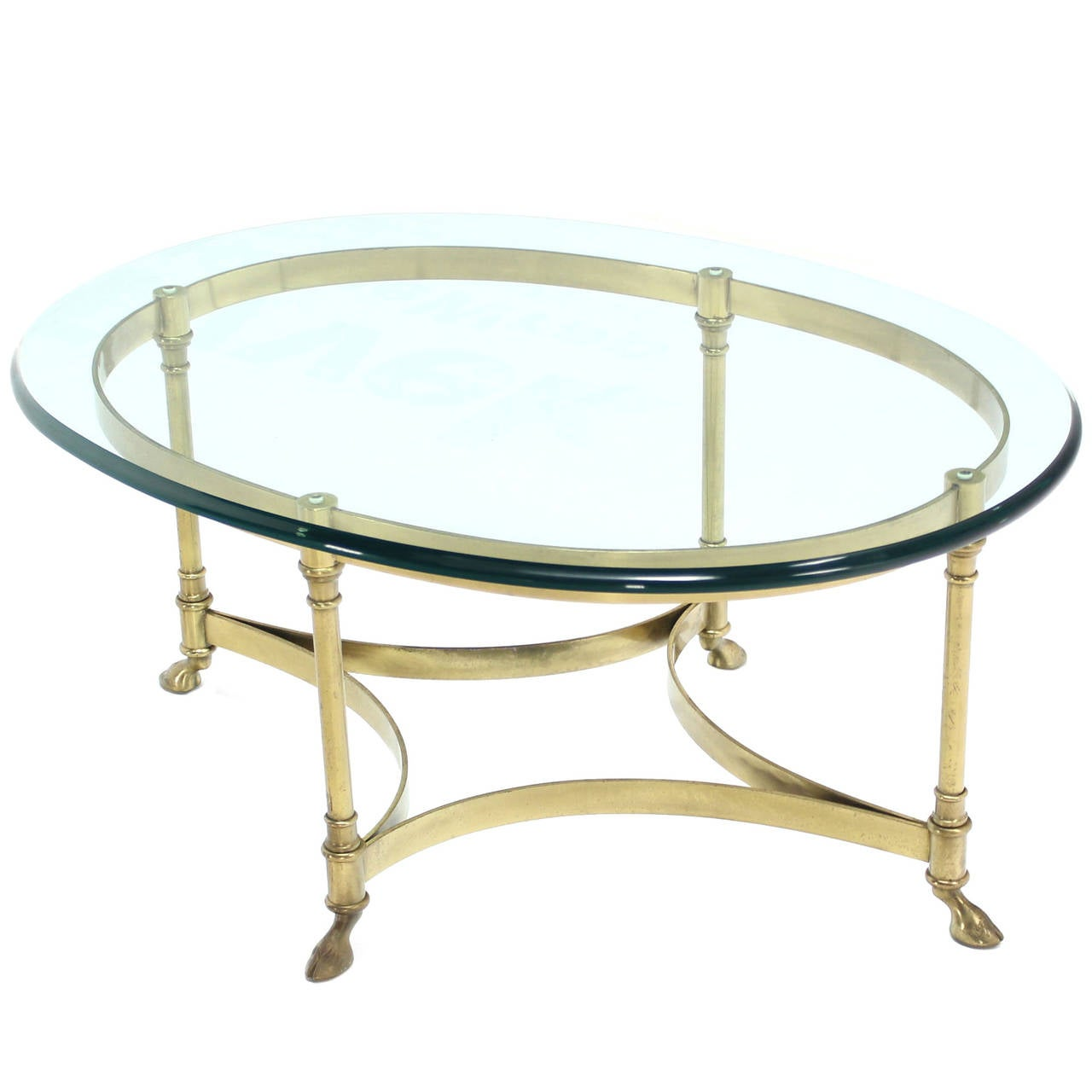 Brass and glass oval hoof feet coffee table Glass oval coffee tables
