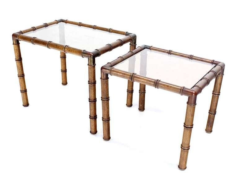 Pair of very nice faux bamboo nesting end tables.