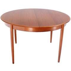 Danish Mid-Century Modern Round Teak Dining Table with Three Leaves