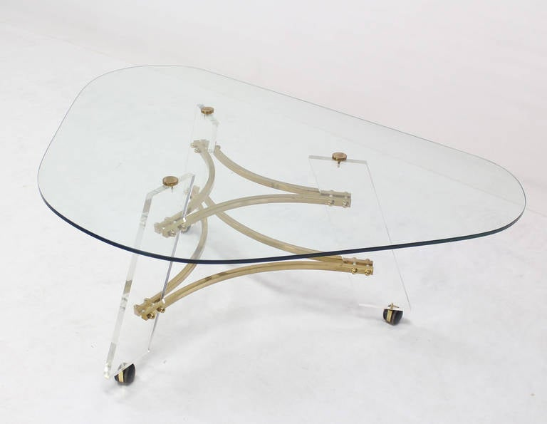 Very nice mid-century modern kidney shape lucite glass and brass coffee table by Charles Hollis Jones.