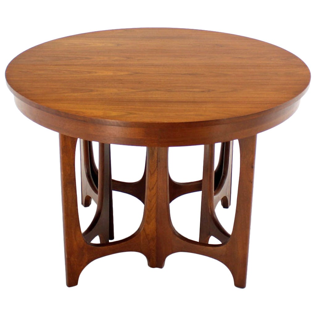 Mid century modern walnut round dining table at 1stdibs for Modern round dining room tables