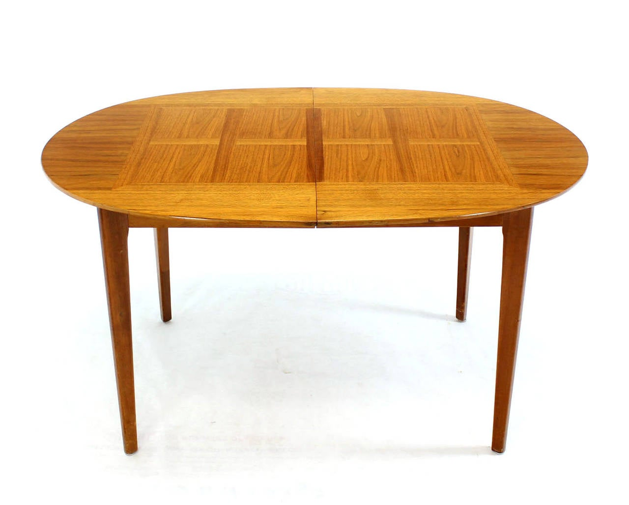 this mid century modern walnut oval dining table with three leaves is