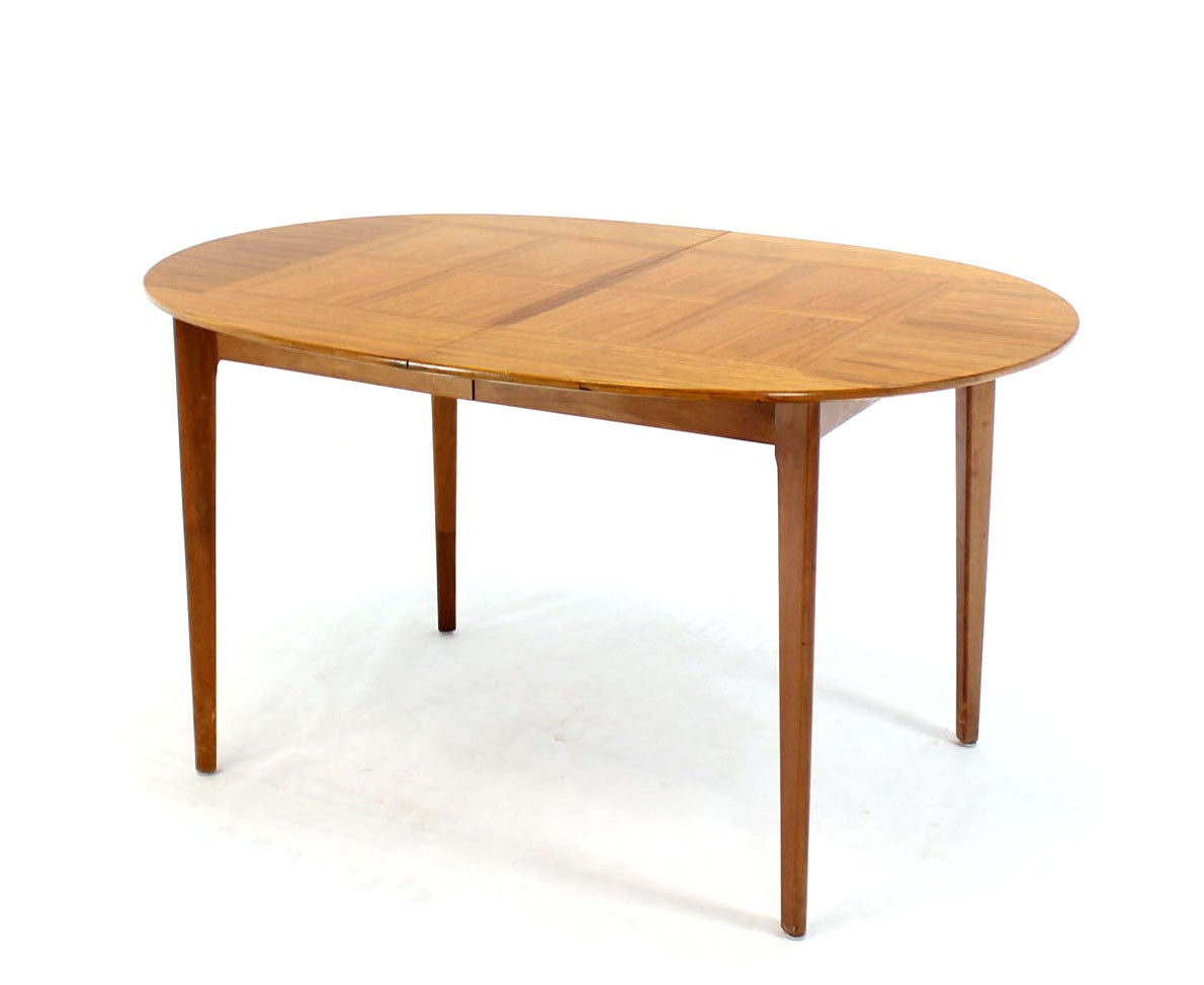 Mid century modern walnut oval dining table with three for Modern dining room table