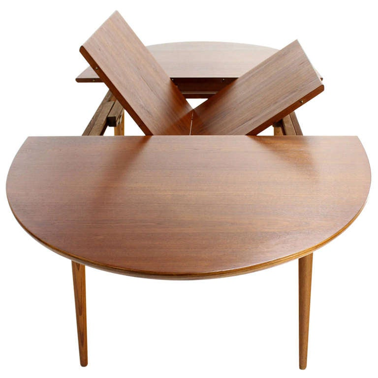 Danish mid century modern oval teak dining table with one for Dining room table with extra leaves
