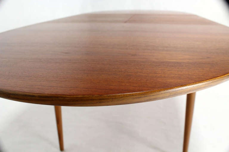 danish mid century modern oval teak dining table with one pop up leaf