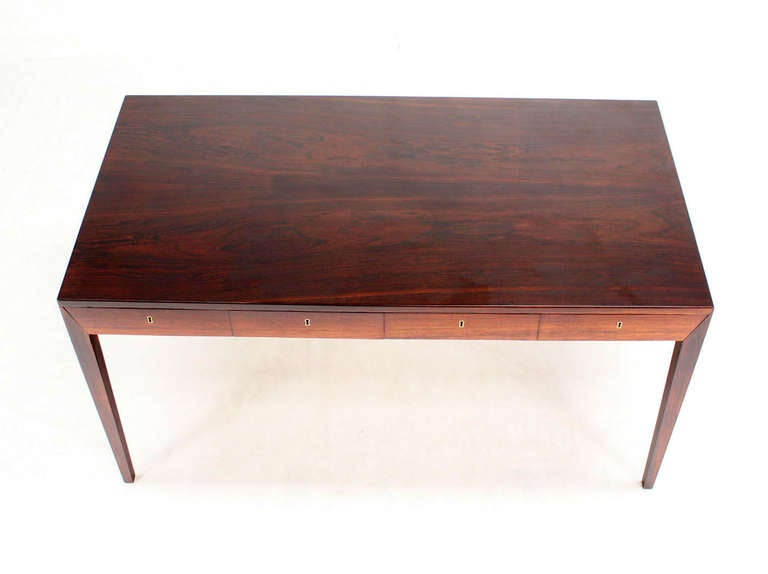 this rosewood danish modern writing table desk with four drawers is no