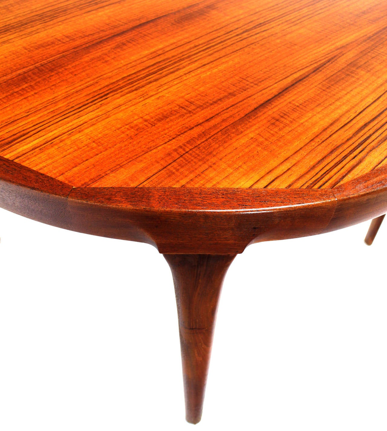 danish mid century modern round teak dining table with two leaves for