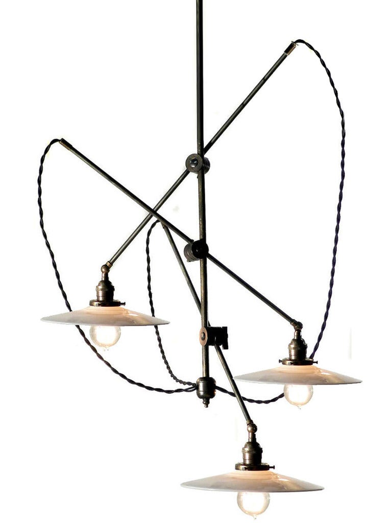 This perfectly sized articulated fixture features 3 matching antique milk glass shades. The arms are all 36 inches long and the shades have 12 inch diameters. The vertical rod is 36 inches as well but can be longer if needed. The chandelier is very