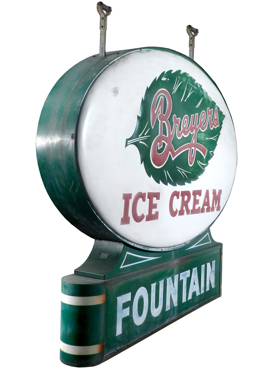 This is a die-cut and embossed sign for a Breyers ice cream fountain. Beautiful artwork and detail went into making this sign from the leaf to the base this sign is one of the more difficult porcelain signs to find. The tin sign is 5 foot wide and