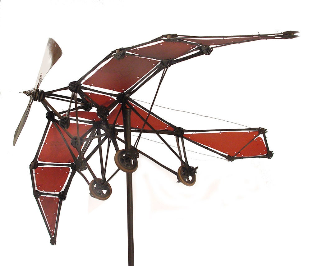 This is the earliest airplane toy model I've ever offered. It has an impressive 30 inch wing span and is 20 inches long. The metal plane parts and stand have the original patina. Note the 3 rubber wheels... the rubber's patina and style are a good