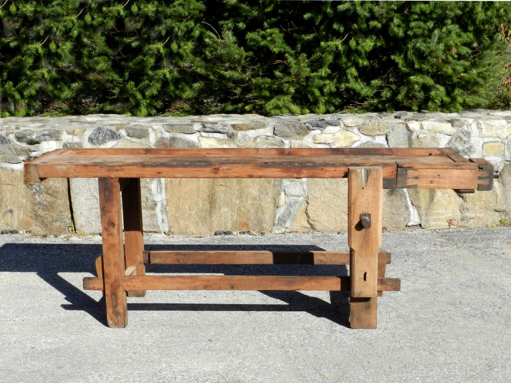 Used for generations by cabinetmakers, this authentic carpenter's workbench from abut 1900 makes a perfect dining room table. The 4 legs are easy to cut down if desired to make a comfortable table hight. For 20 years our own dining table has been an