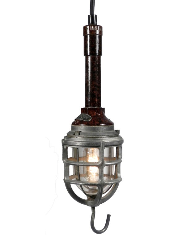 Compared to a common trouble light these 3 examples would be considered monumental. 2 have glass domes, 2 have secondary inner cages and all have heavy cast aluminum outer cages. They each weigh at least 6-7 pounds. The makers are Appleton and