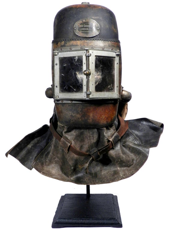 This is an early Siebe Gorman smoke mask. These full face helmets are very rare and found mostly in museum collections. It's signed on a brass plaque... Mfgd by Siebe Gorman and Company, London England. The front has doors that swing open and use
