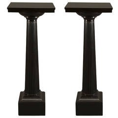 A Superbly Drawn And Executed Pair Of Columnar Ashford Black Marble Stands