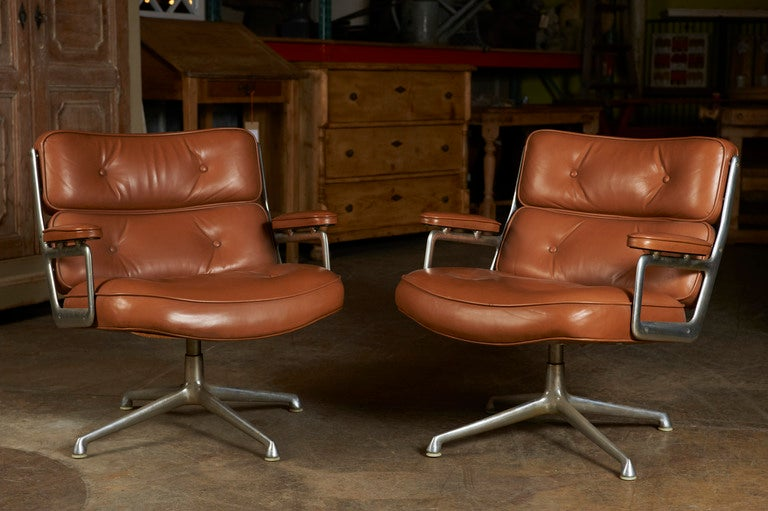Herman Miller swivel chair, c. 1960, covered in leather on aluminum bases, purportedly from the Time-Warner Building. One available.