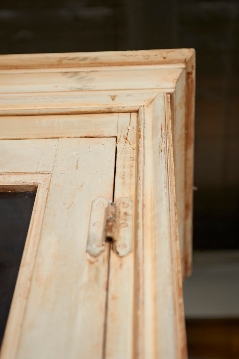 French painted pine bibliotheque, mid-19th century original glass in the glazed top panels and the base with fielded panels.