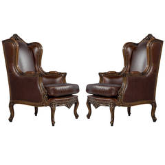Pair of Mahogany Leather Louis XV Wing Chairs