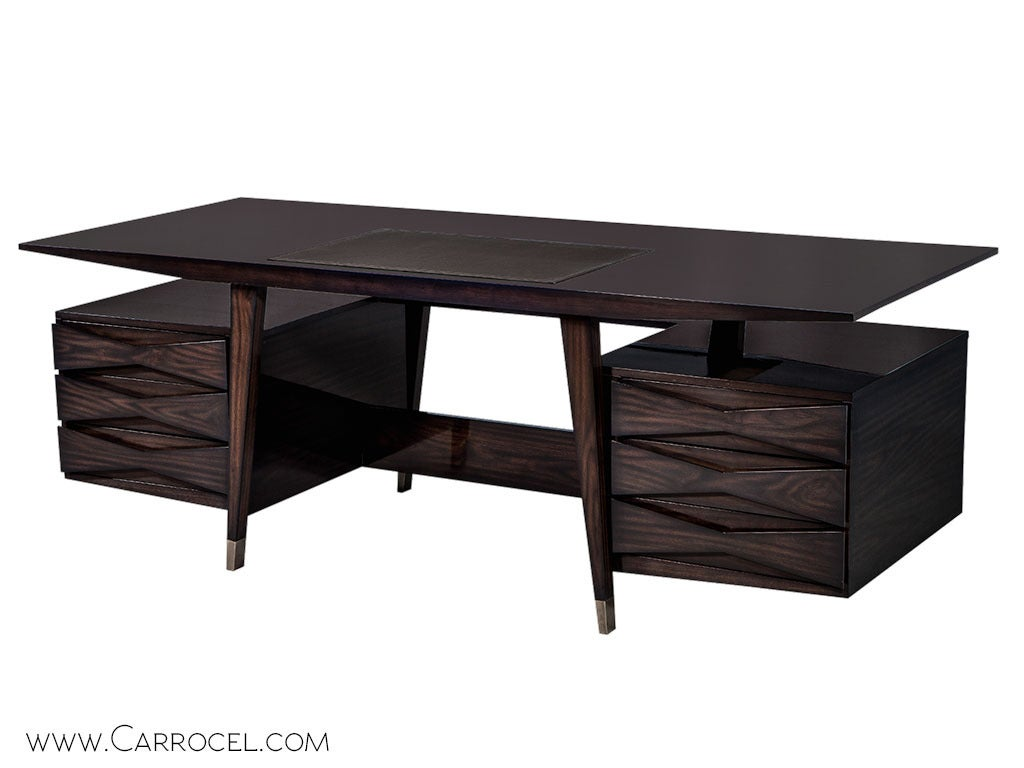 Coupling both classic and modern elements into one stylish design, this writing desk from the Carrocel Custom collection presents a picture of flat cut walnut elegance. A rectangular floating top with inset leather and tapered sides rests on splayed
