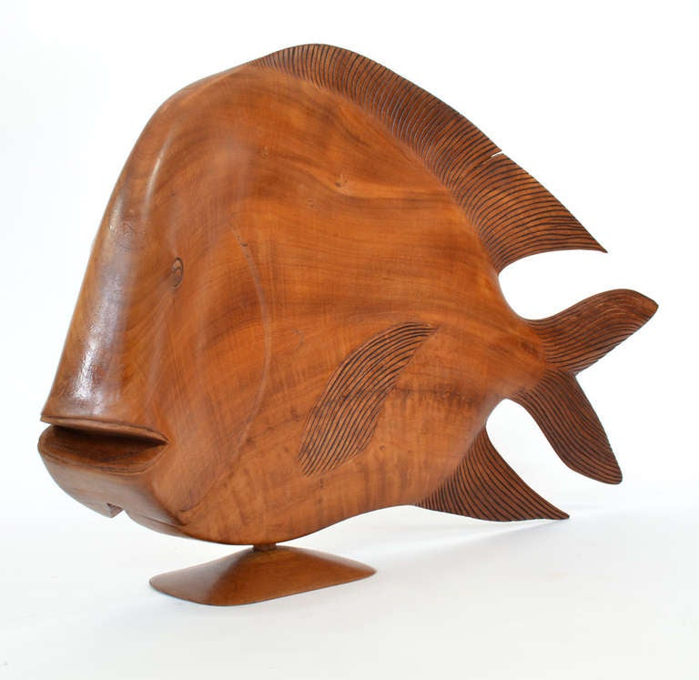 Exquisite large scale Brazilian wood carving of a fish. Modern handworked exotic wood sculpture depicting a tropical or game fish in motion, mounted on a wood base.
