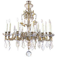 An Elegant Continental Rococo Style Gilt-Bronze & Crystal 12-Light Chandelier