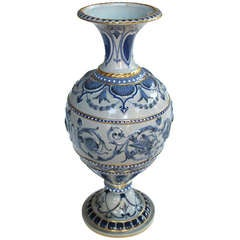 A Shapely English Blue Polychromed Porcelain Urn with Relief Decoration by Spode